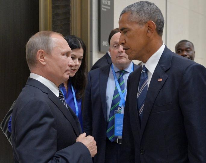 Cuộc đối mặt chưa từng tiết lộ giữa 2 ông Obama, Putin - Ảnh 1.