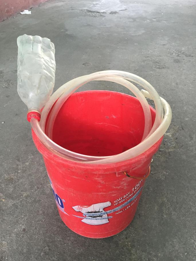 Bắt quả tang bơm nước vào miệng số heo hơn 1 tấn - Ảnh 2.