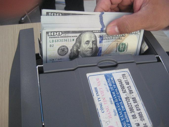 Chỉ trong 3 ngày từ 13 đến 15-2, tỉ giá VNĐ/USD đã tăng gần 120 đồng/USD