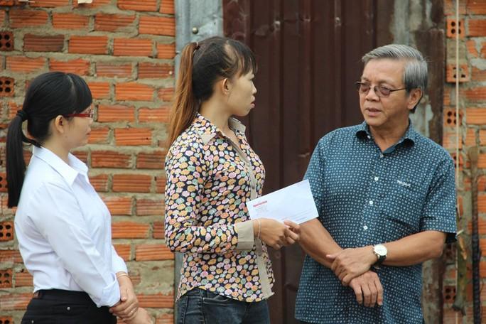 Báo Người Lao Động hỗ trợ công nhân Khánh Hòa tan hoang nhà cửa sau bão - Ảnh 3.