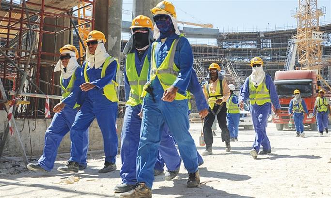 Hạn chế tuyển và đưa lao động mới sang Qatar - Ảnh 1.