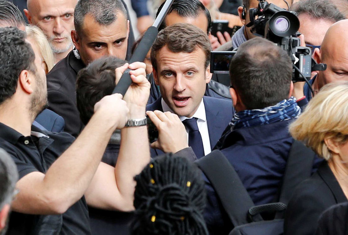 Bầu cử tổng thống Pháp nóng trước giờ G - Ảnh 1.