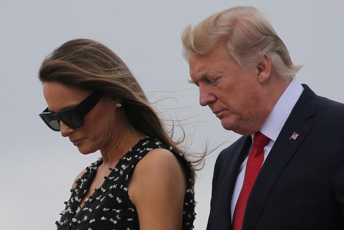 Vợ chồng Tổng thống Trump Ảnh: REUTERS