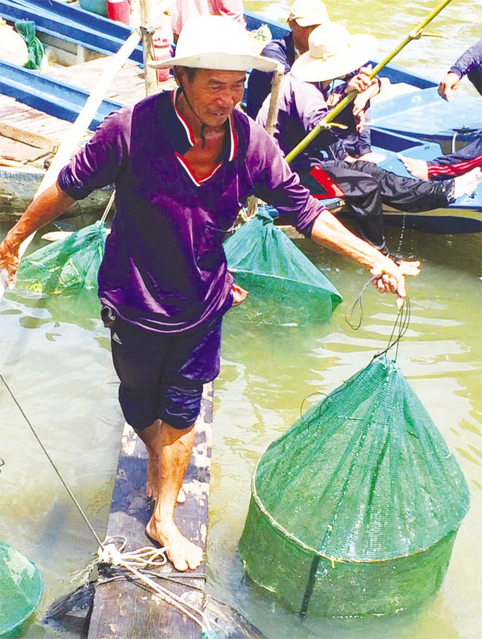 Phập phồng di cư theo con cá đồng mùa lũ - Ảnh 2.