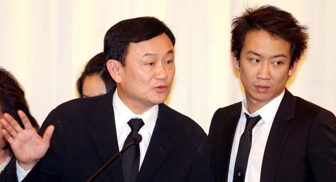 Con trai ông Thaksin bị khởi tố tội rửa tiền - Ảnh 1.