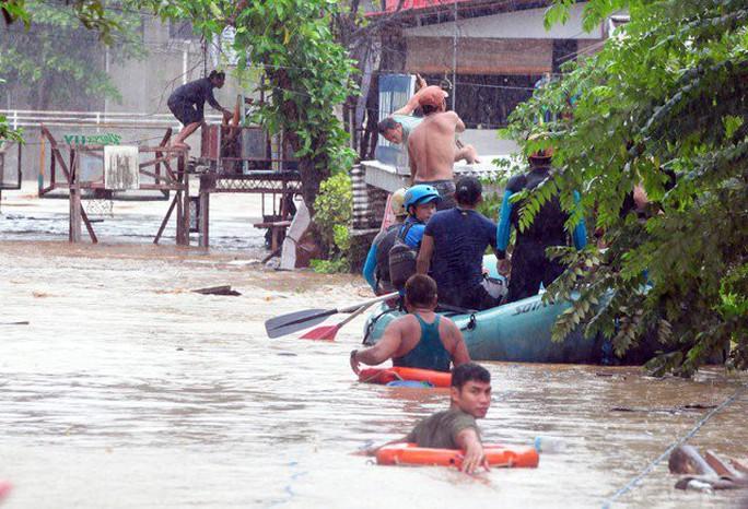 Tiến về Việt Nam, bão Tembin làm 133 người chết ở Philippines - Ảnh 3.