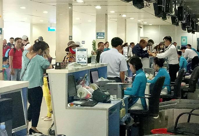 Vietnam Airlines tăng 1.100 chuyến bay Tết, khuyến cáo ra sân bay sớm - Ảnh 1.