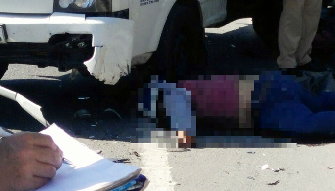 Xe tải lấn đường tông chết người đi xe máy - Ảnh 1.
