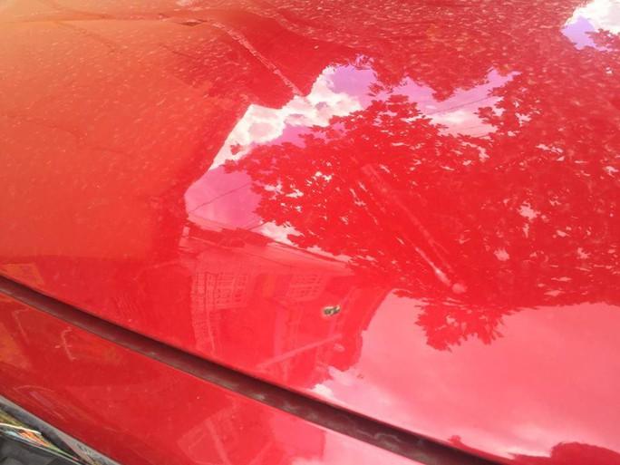 Công an vào cuộc vụ 9 ô tô bị đập ở quận 10 - Ảnh 1.