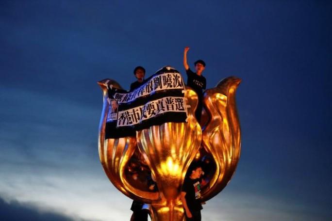 Hồng Kông: Bắt người biểu tình trước chuyến thăm của Chủ tịch Trung Quốc - Ảnh 2.