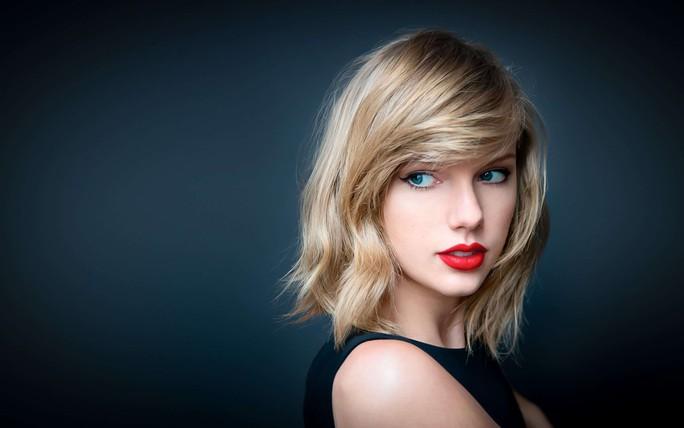 Taylor Swift đánh bại kỷ lục của Adele  - Ảnh 1.