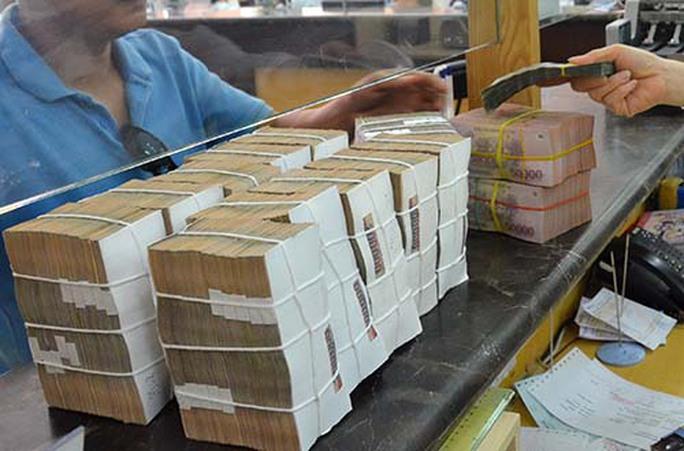 Chính phủ cần vay thêm gần 500.000 tỉ đồng để bù đắp chi tiêu  - Ảnh 1.