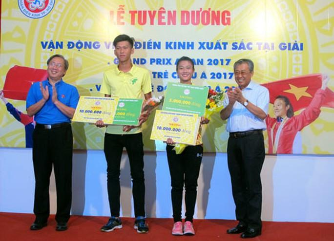 Điền kinh TP HCM trao thưởng cho VĐV xuất sắc - Ảnh 1.
