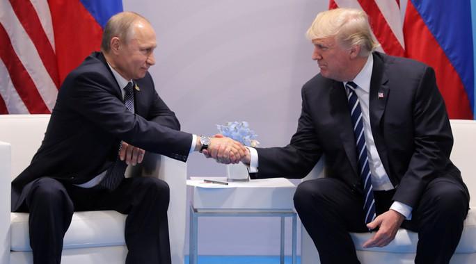 Tổng thống Mỹ - Nga lần đầu gặp nhau - Ảnh 1.