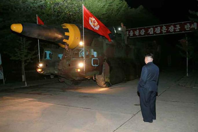 Triều Tiên nói vụ thử tên lửa mới thành công - Ảnh 5.