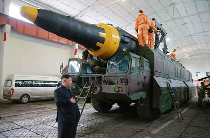 Triều Tiên nói vụ thử tên lửa mới thành công - Ảnh 4.