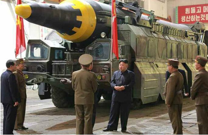 Triều Tiên nói vụ thử tên lửa mới thành công - Ảnh 3.