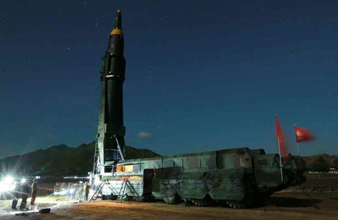 Triều Tiên nói vụ thử tên lửa mới thành công - Ảnh 7.