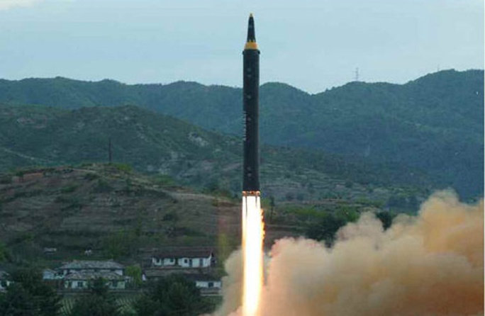 Triều Tiên nói vụ thử tên lửa mới thành công - Ảnh 9.