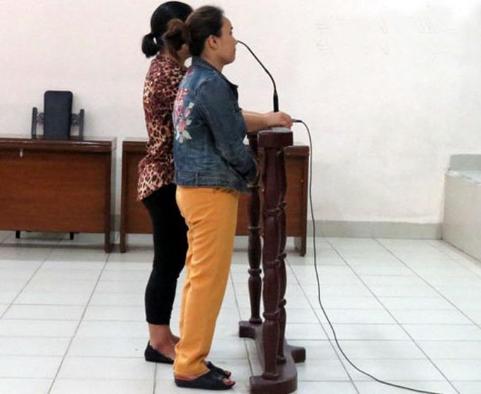 2 phụ nữ hắt chất bẩn vào phản thịt lợn lĩnh 9 tháng tù treo - Ảnh 1.