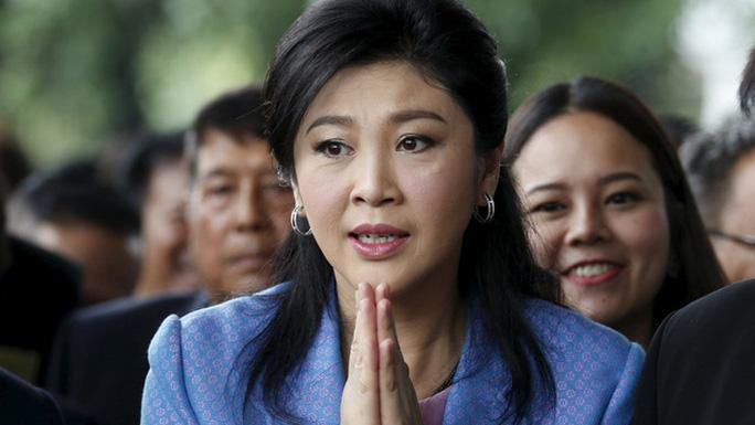 Interpol đồng ý truy nã xanh bà Yingluck - Ảnh 1.