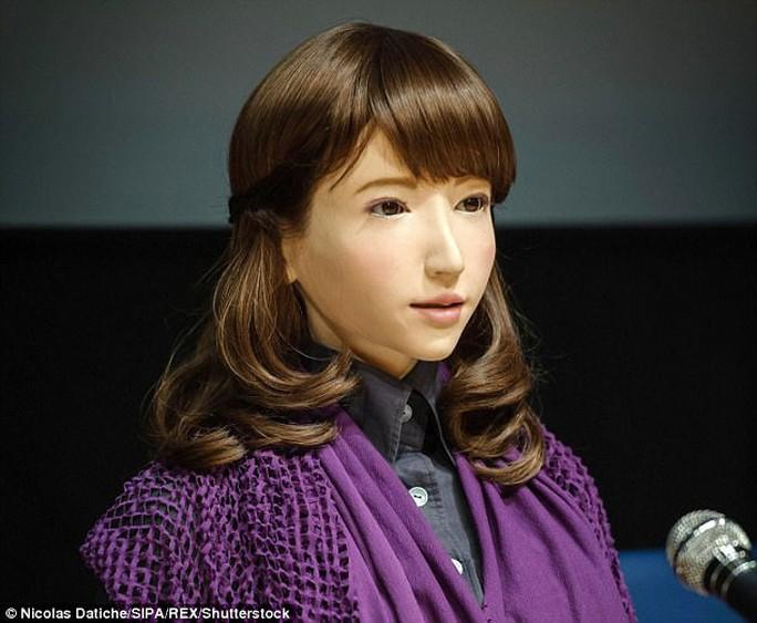 Cận cảnh robot phát thanh viên truyền hình xinh đẹp Nhật Bản - Ảnh 3.
