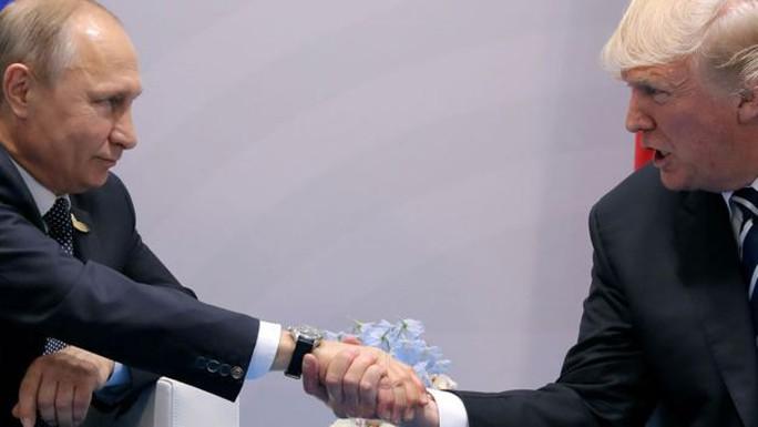Tổng thống Putin cười nhạo danh sách Putin - Ảnh 1.
