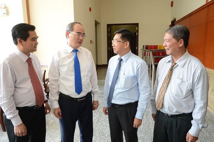 Văn phòng Thành ủy TP HCM sẽ thôi làm kinh tế - Ảnh 1.