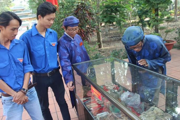 Truy điệu các liệt sĩ được tìm thấy trong hố chôn tập thể ở Đồng Nai - Ảnh 3.