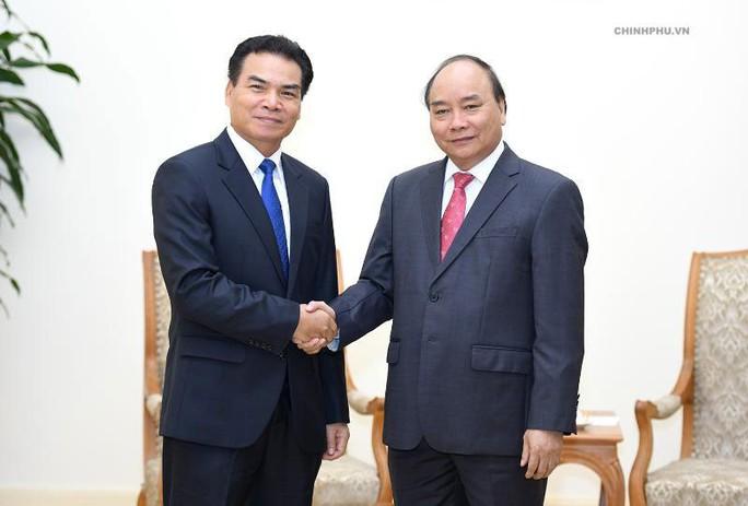 Việt - Lào chia sẻ kinh nghiệm điều hành kinh tế - Ảnh 1.