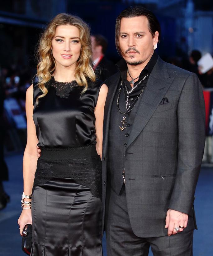 Tài tử Johnny Depp tố ngược vợ cũ - Ảnh 1.