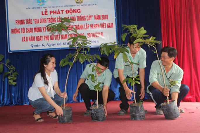 CNVC-LĐ hưởng ứng phong trào Gia đình trồng cây xanh - Ảnh 1.
