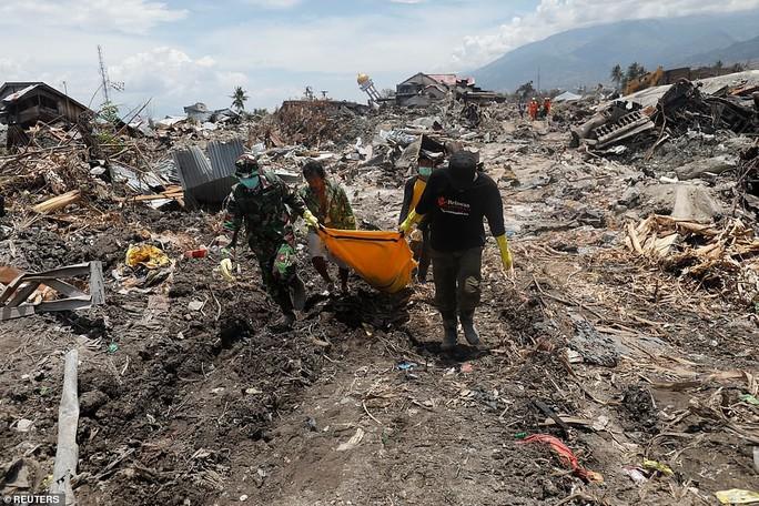 Sóng thần Indonesia: Cận cảnh đất hóa lỏng nhấn chìm cả làng - Ảnh 5.