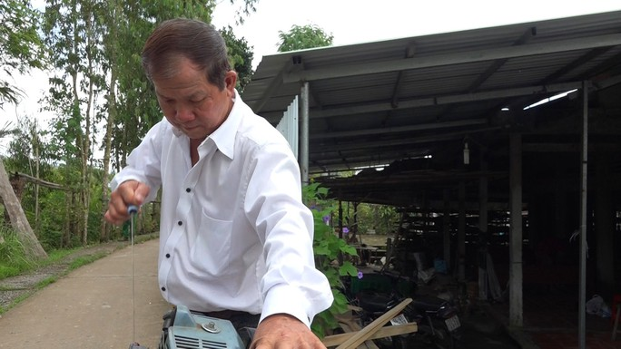 """Lão nông chế tạo xe đạp chạy bằng máy cắt cỏ """"độc nhất vô nhị"""" - Ảnh 9."""