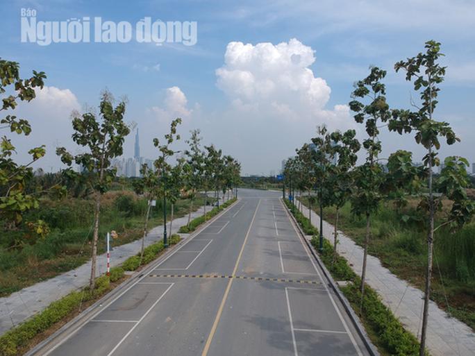 Cận cảnh 4 tuyến đường lùm xùm ở Thủ Thiêm - Ảnh 10.