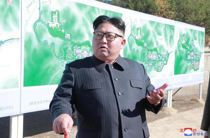 Ông Kim Jong-un bất ngờ thông báo thử thành công vũ khí chiến lược mới - Ảnh 1.