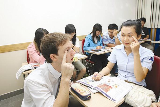 Lao động nước ngoài đóng BHXH bắt buộc: Vẫn phải tiếp tục chờ hướng dẫn - Ảnh 1.
