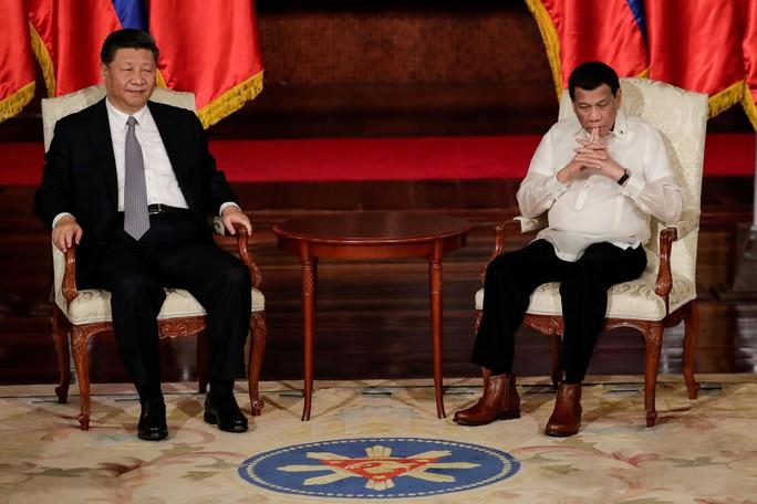 Philippines ký thỏa thuận thăm dò dầu khí với Trung Quốc - Ảnh 4.