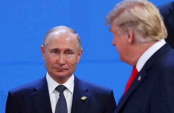Ông Putin tiết lộ cuộc nói chuyện ngắn với ông Trump ở G20 - Ảnh 1.