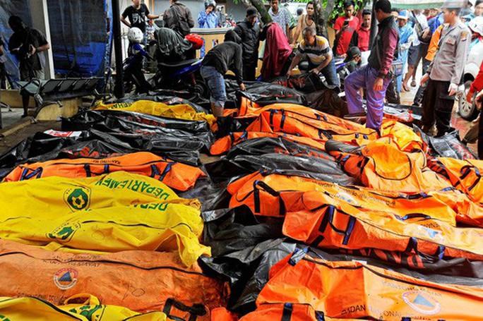 Indonesia: Sau sóng thần chớp nhoáng là động đất và thảm họa lơ lửng - Ảnh 4.
