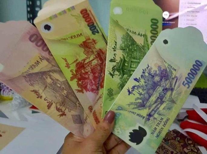 Cẩn trọng với bao lì xì mệnh giá 500.000 đồng - Ảnh 1.