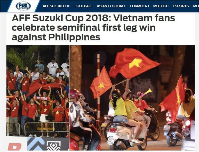 Báo nước ngoài choáng ngợp bởi màn ăn mừng của CĐV Việt Nam - Ảnh 4.