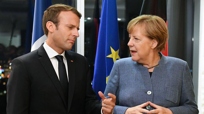 Nga vùi dập yêu cầu của bà Merkel và ông Macron - Ảnh 1.