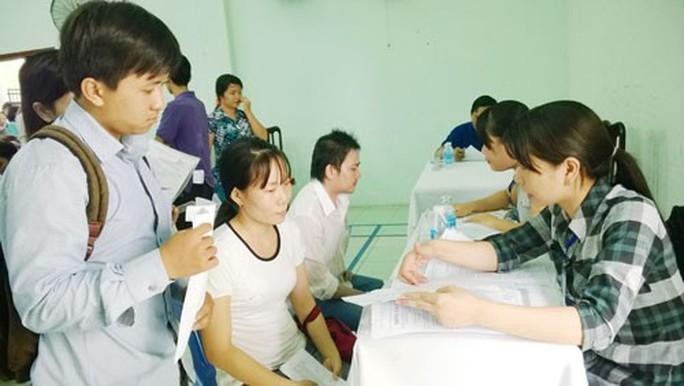 TP HCM: Hơn 300.000 lao động được giải quyết việc làm - Ảnh 1.