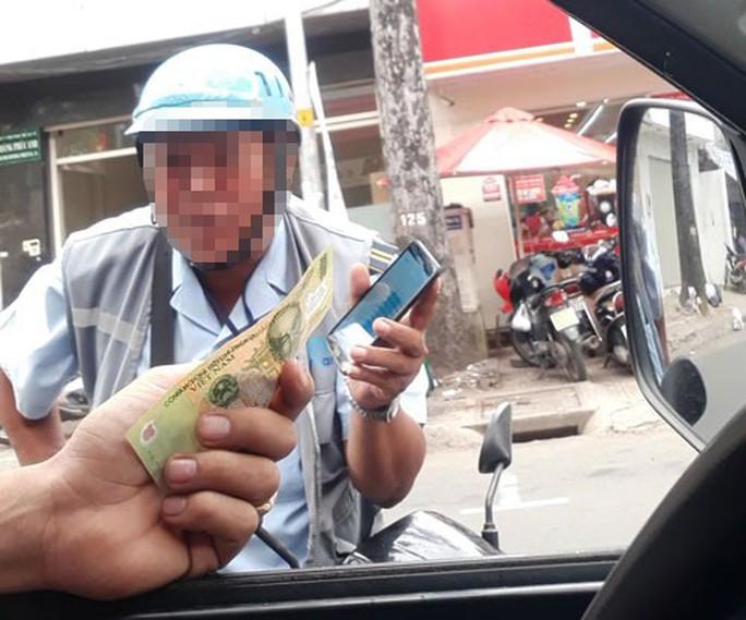 Lãnh đạo TP HCM thừa nhận có việc bỏ túi riêng trong thu phí đậu ôtô - Ảnh 2.