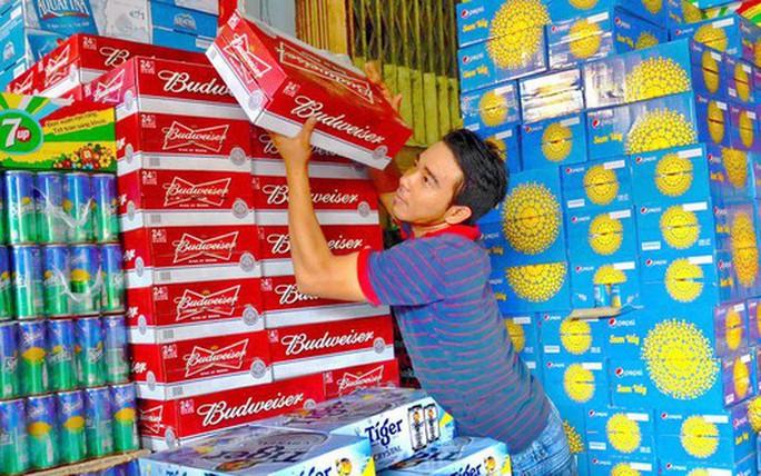 TP HCM: Dự kiến tiêu thụ khoảng 44 triệu lít bia dịp Tết 2018 - Ảnh 1.
