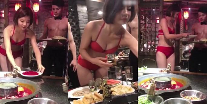 Tri ân khách, nhà hàng lẩu cho người mẫu mặc bikini phục vụ - Ảnh 1.