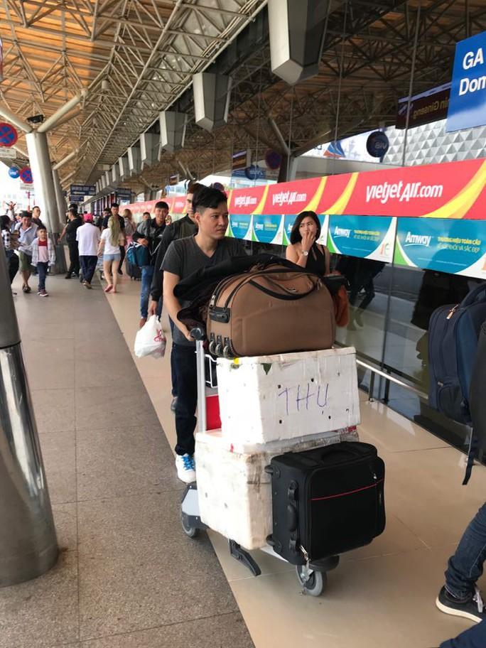 30 tháng chạp: Bến xe vắng hoe, sân bay Tân Sơn Nhất vẫn đông nghẹt - Ảnh 14.