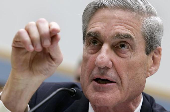 Mỹ cáo buộc 13 người Nga can thiệp bầu cử - Ảnh 1.