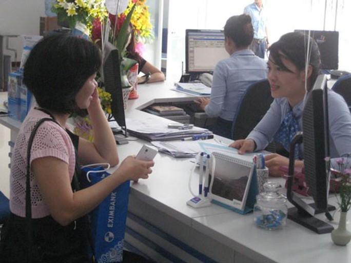 Vụ Phó giám đốc Eximbank TP HCM cuỗm 301 tỉ đồng bỏ trốn: Lỗ hổng kiểm soát tiền gửi - Ảnh 1.